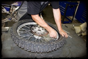 Work New Dirt Bike Tire Onto Rim